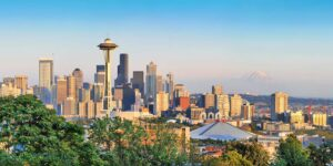 Seattle skyline with the space needle and Mount Rainier in the background.